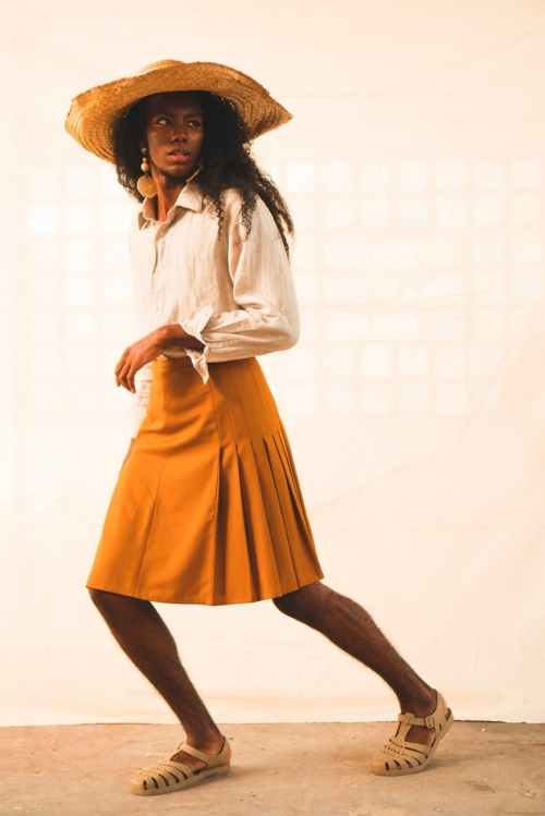 woman wearing yellow skirt and white long sleeved top photo